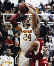 Tulare Union's Keonta Vernon goes up for a shot against East Bakersfield at Tulare Union on Tuesday, February 28, 2012.