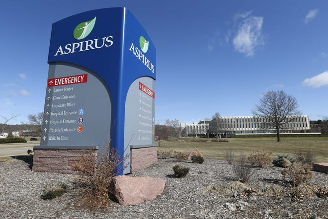 Aspirus Wausau Hospital is pictured March 30. The health system announced Wednesday it will furlough some employees and reduce hours as it grapples with the coronavirus.