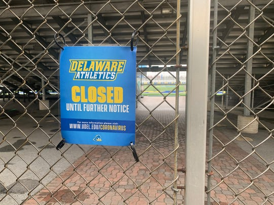 A sign attached to the fence at the south end of Delaware Stadium.