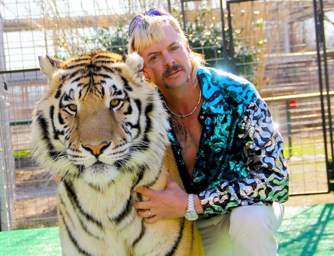 """Netflix TV show """"Tiger King"""" main character Joe Exotic with one of his tigers."""