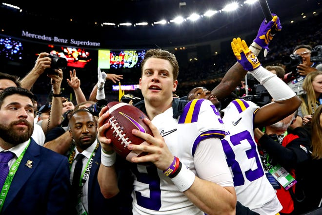 LSU Tigers quarterback Joe Burrow (9) celebrates after beating the Clemson Tigers in the College Football Playoff national championship game at Mercedes-Benz Superdome.