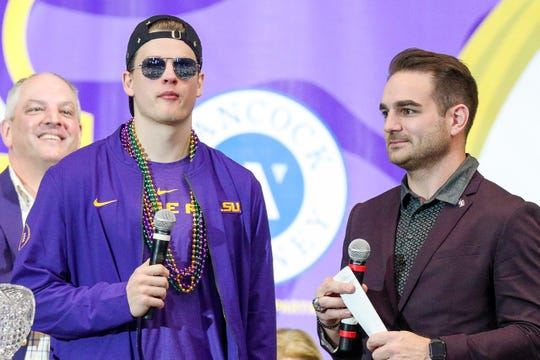 LSU Tigers quarterback Joe Burrow (9) is interviewed by former LSU fullback Jacob Hester during the LSU championship trophy presentation at Pete Maravich Assembly Center.