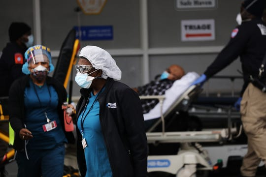 Medical workers take in patients in New York, on April 6, 2020.