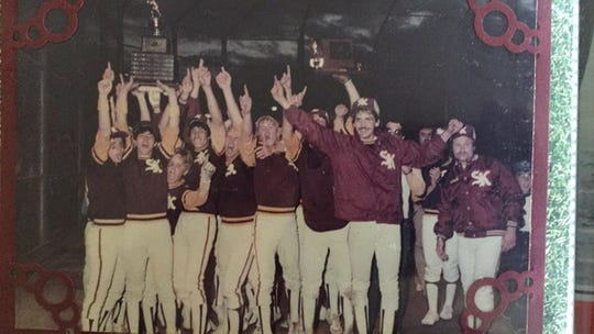 The 1983 South Kitsap Wolves celebrate their state title, the first won by hall of fame coach Elton Goodwin.