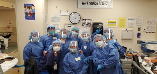 Amanda Lancheros and Becky Enright with a group of nurses working the night shift at Lincoln Medical Center in the Bronx. The pair are nurses at Harrison Medical Center who flew to help out in New York City, which has been overwhelmed with fatal cases of COVID-19.
