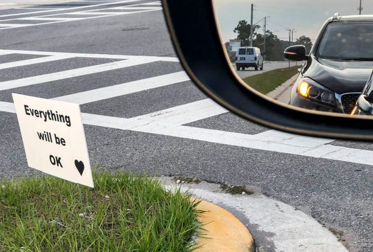 Message of hope: A sign left anonymously in a median in Rockledge, Florida, during the coronavirus pandemic predicts better times ahead.