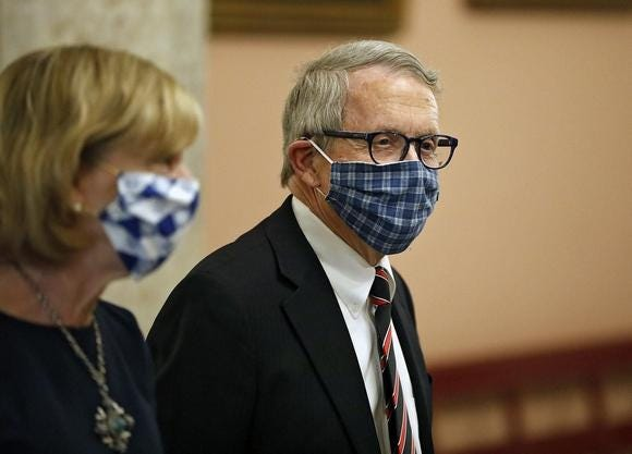 Ohio Gov. Mike DeWine and his wife, Fran, leave the State Room after giving an update on the response to the COVID-19 pandemic April 10 at the Ohio Statehouse.