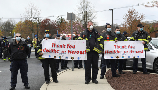 Edison Office of Emergency Management officials cheer for the healthcare heroes at Hackensack Meridian JFK Medical Center.