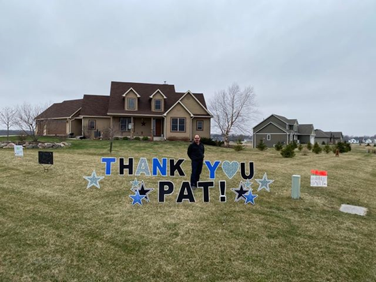 Dr. Patrick Tracy with the signs neighbors posted in his Ames-area yard to express their appreciation for his decision to serve as a medical fill-in in Philadelphia, the latest hot spot to emerge in the coronavirus pandemic.  (Tuesday, April 7)