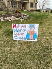One of the signs neighbors posted in Dr. Patrick Tracy's Ames-area yard to express their appreciation for his decision to serve as a medical fill-in in Philadelphia, the latest hot spot to emerge in the coronavirus pandemic.  (Tuesday, April 7)