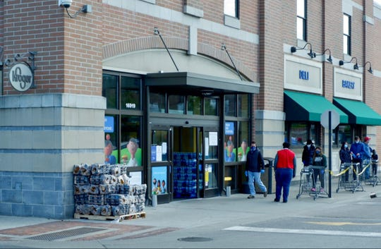 Shoppers seen outside the Kroger at 16919 Kercheval in Grosse Pointe on April 11, 2020. Kroger announced that four employees at four Metro Detroit locations have died after contracting COVID-19.