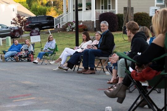 Families sit in distanced groupings while Al Phillips, director of missions for the Greenville Baptist Association, leads a Good Friday worship in his neighborhood Friday, April 10, 2020. Phillips and his neighbors gathered for the holiday while trying to maintain social distancing.