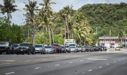 A long line of traffic forms due to road closures ordered by Gov. Lou Leon Guerrero, on Route 1 in east Hagåtña, April 11, 2020.