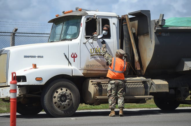 Motorists on Route 8 in Barrigada are stopped by members of the Guam National Guard at a road closure, April 11, 2020. In accordance with Gov. Lou Leon Guerrero's order to deter non-essential travel, the Guam National Guard and Guam Police Department have set up road closures along sections of Route 1 and Route 8, from 10 a.m. to 10 p.m. daily, according to the Department of Public Works.