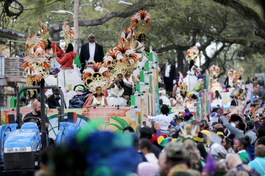 FILE - In this Feb. 25, 2020, file photo, the Krewe of Zulu Parade rolls down Jackson Avenue on Mardi Gras Day in New Orleans. In a city ravaged by the coronavirus outbreak, Zulu and its members have paid a heavy price. Several of the group's members have died from coronavirus-related complications, said Zulu President Elroy A. James. Multiple other members have tested positive. (AP Photo/Rusty Costanza, File)