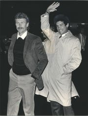 Centerfielder Robin Yount (left), whose catch ended the game, and Juan Nieves greeted fans at the airport after the Milwaukee Brewers returned home following Nieves' no-hitter in Baltimore.