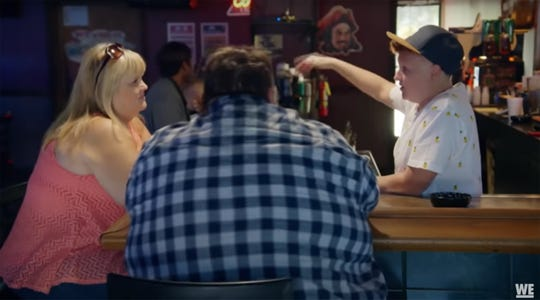 """Doe Doe and Big Mike chat with bartender Tiffany Burton at Montgomery's The Zip Line in season 4, episode 3 of """"Mama June: From Not to Hot."""""""