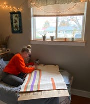 Heath senior Sydney Mason completes work at home, in a photo submitted for the school's yearbook.