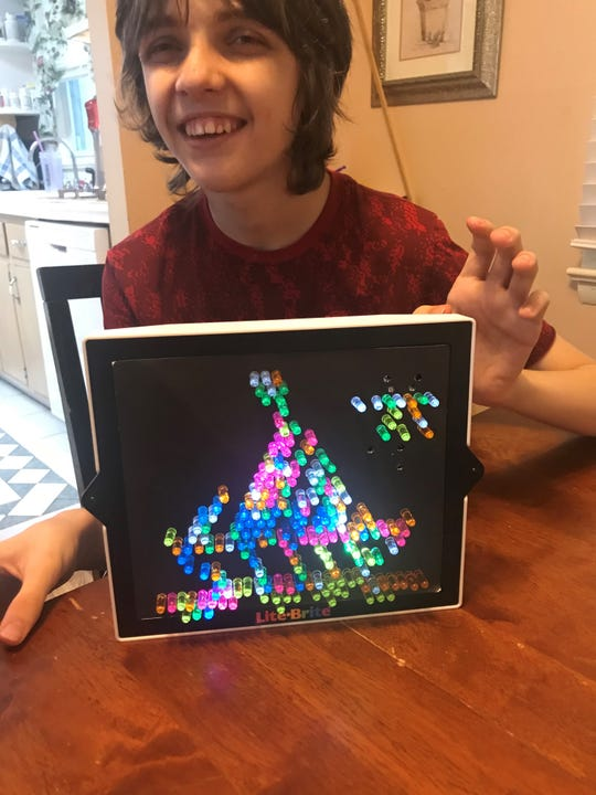 Nathaniel Lesch participates in remote learning at his home in Bloomingdale. April 9, 2020.