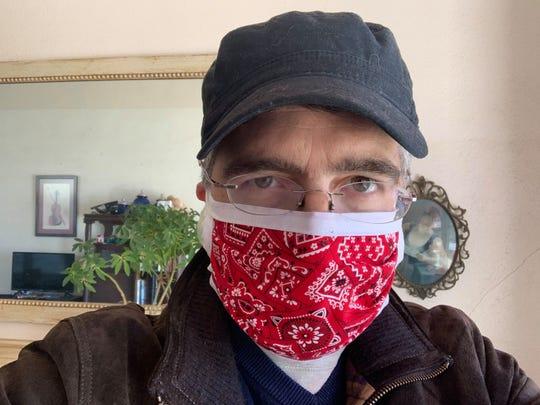 Desert Sage columnist and Sun-News reporter Algernon D'Ammassa models a custom-designed cotton mask on April 9, 2020.
