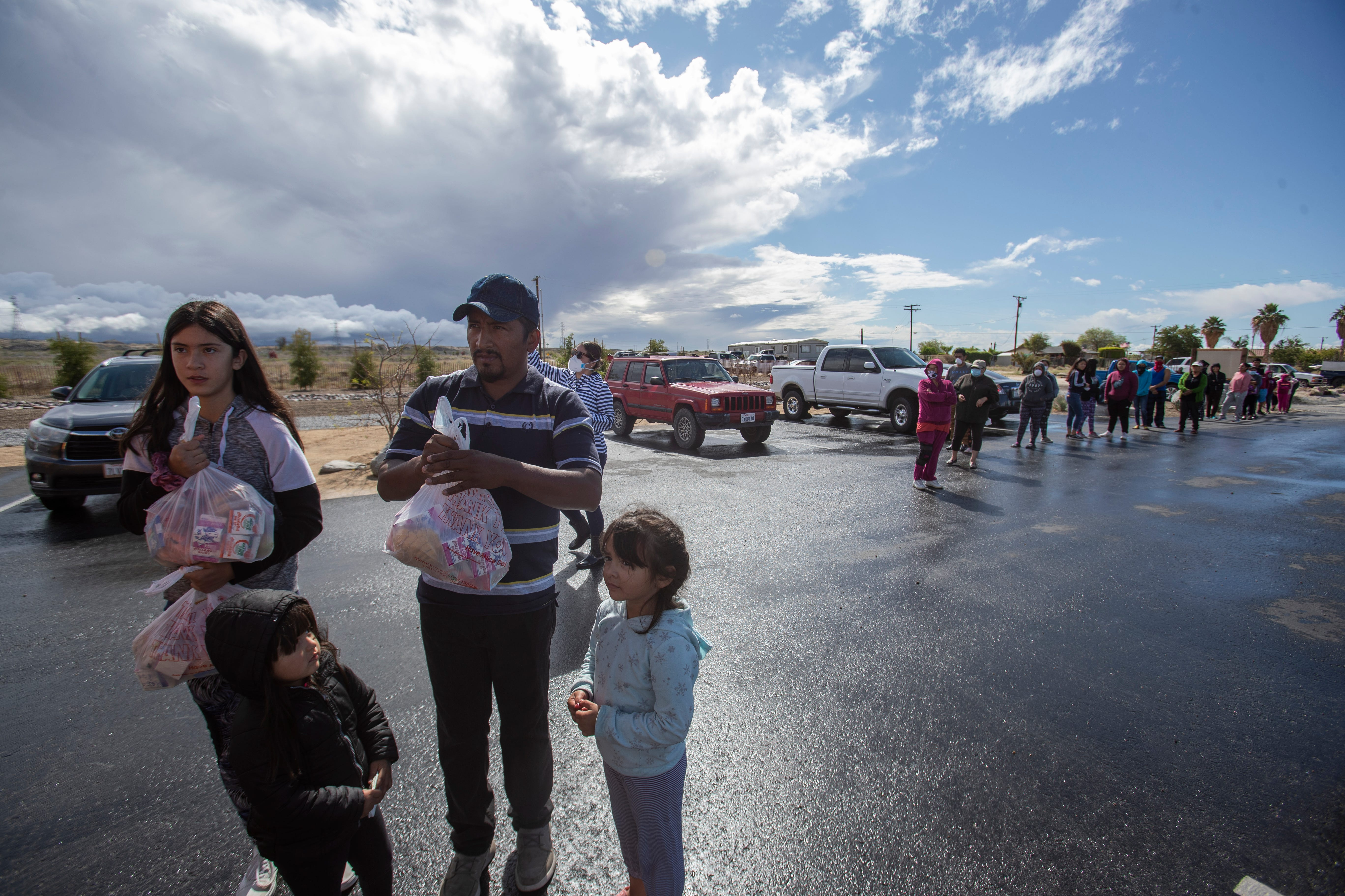A farmworker family receives food from the Coachella Valley Unified School District in North Shore.