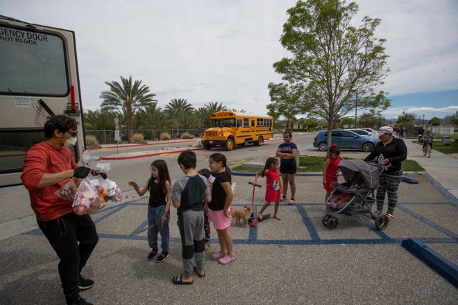 Omar Sotelo, delivers food to children in Mecca as part of the Coachella Valley Unified School District food distribution for students in their school district. Many farmworkers have seen their income reduced under COVID-19 and are now more dependent on food for their children from the school district.