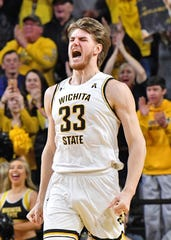 Feb 28, 2019; Wichita, KS, USA; Wichita State Shockers center Asbjorn Midtgaard (33) reacts after a dunk against the Connecticut Huskies during the second half at Charles Koch Arena. Mandatory Credit: Peter G. Aiken/USA TODAY Sports