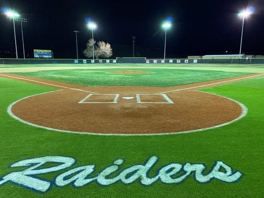 The Reed baseball field is shown at night last week.