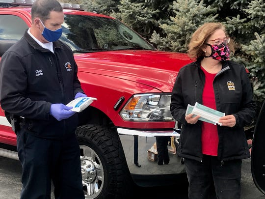 Reno Battalion Chief Andrew Ancho and Councilwoman Naomi Duerr donate masks to the Lakeside Health & Wellness Suites on Saturday, April 11, 2020.