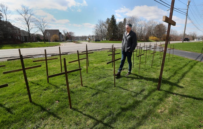 On Easter, New York vet builds crosses in yard to honor every coronavirus victim in his county
