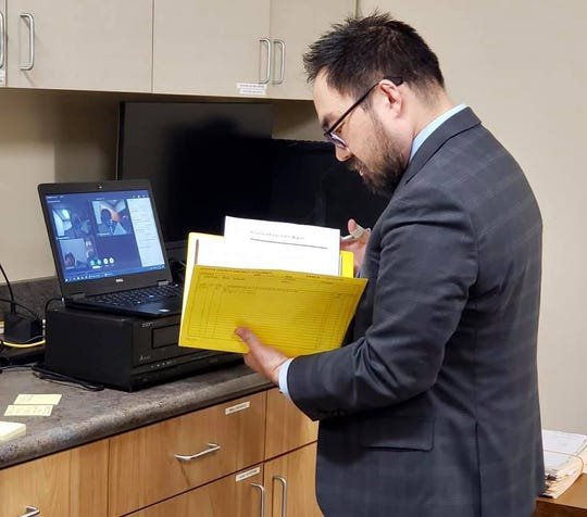 The Shasta County District Attorney's Office posted a photo on its Facebook page Friday, April 10, 2020  showing a prosecutor present for an arraignment taking place using video.