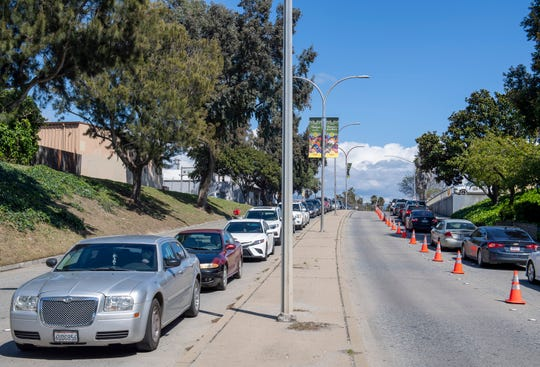 The long line of cars caused a traffic jam on E. Alisal Street on Friday, April 10, 2020.