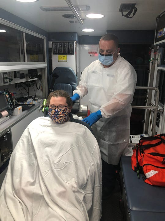 Talbot County paramedics demonstrate how masks will be used in transporting patients.