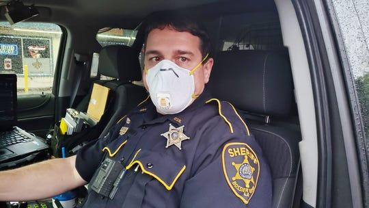 Pictured is a Bossier Parish Sheriff's deputy wearing a mask.
