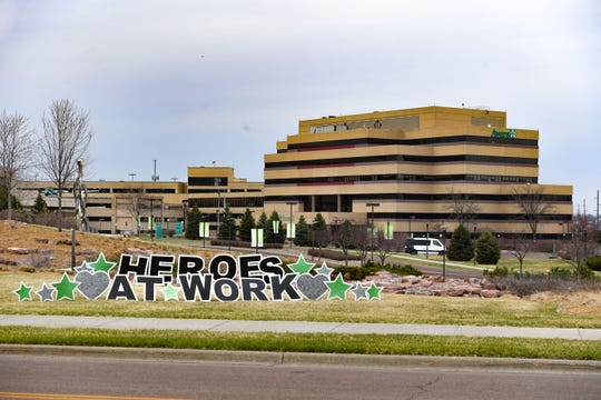 "A large lawn sign reads ""heroes at work"" outside the Avera hospital on Saturday, April 11, in Sioux Falls."