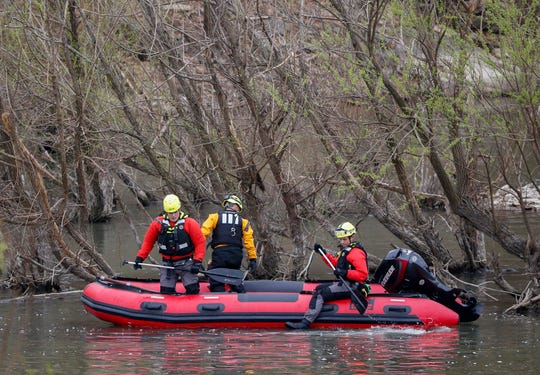 A water rescue team from the Springfield Fire Department searches the water near the Lake Springfield Dam spillway for a missing man on Saturday, April 11, 2020.
