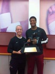 FSU athletics trainer Jerry Latimer with FSU quarterback and Heisman Trophy winner Jameis Winston.