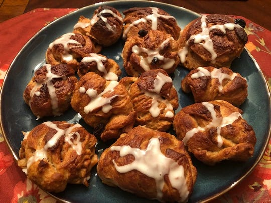 Hot cross buns with icing on top and chock full of fruits and raisins are an Easter treat.