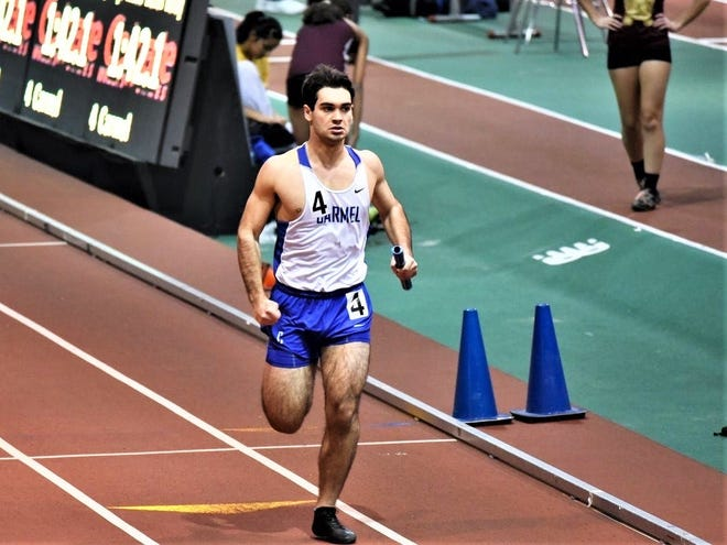 Carmel's Ryan Fischer, shown running a relay at The Armory, will compete for SUNY-Geneseo's club team next year.