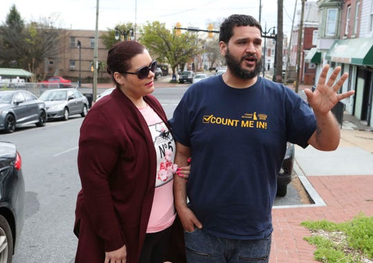 Carmen Colon and Alberto Maldonado say they have many concerns about the coronavirus as they arrive at the Latin American Community Center's childcare center to pick up one of their children Thursday.