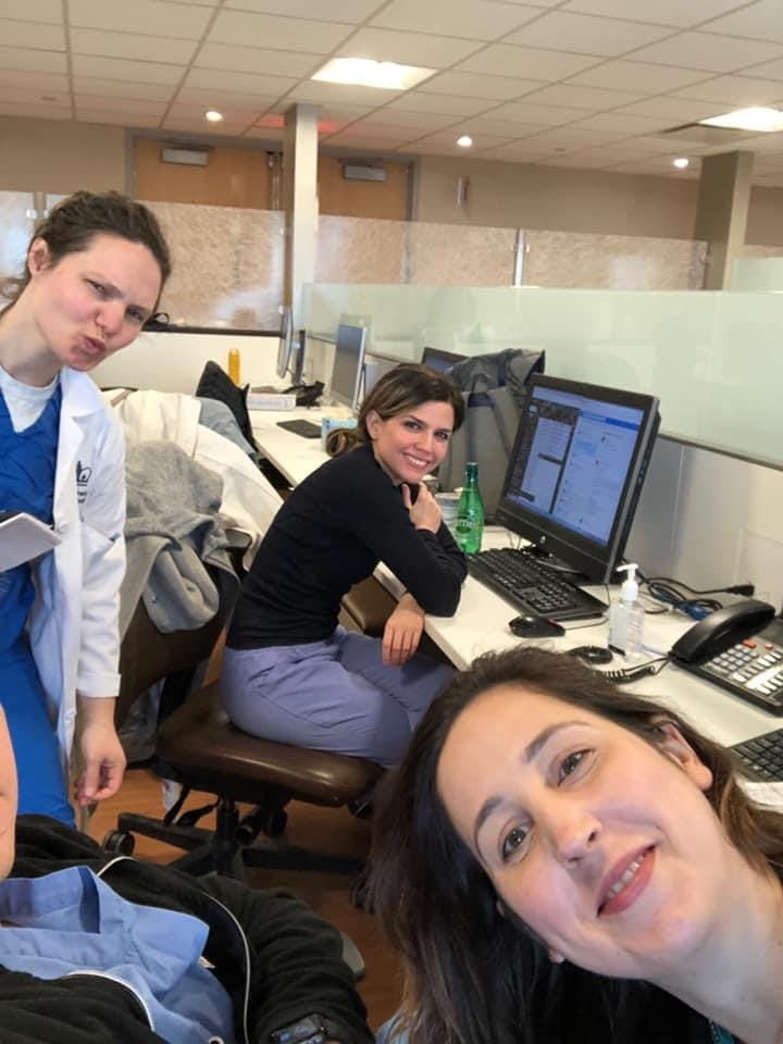 """Dr. Elissa Szalkiewicz (left), Dr. Susana Bejar (middle), and Dr. Lauren Parks take a moment recently at the Columbia University Irving Medical Center in New York. Bejar said the staff has been working together to deal with the coronavirus outbreak. """"Everyone is trying to figure out a way to help,'' she said."""