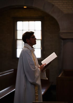 Rev. Nathan D. Pipho gives an Easter message to an empty church at Trinity Lutheran Church on Saturday, April 11, 2020. The service was videotaped and will be broadcast to parishioners on Easter Sunday.