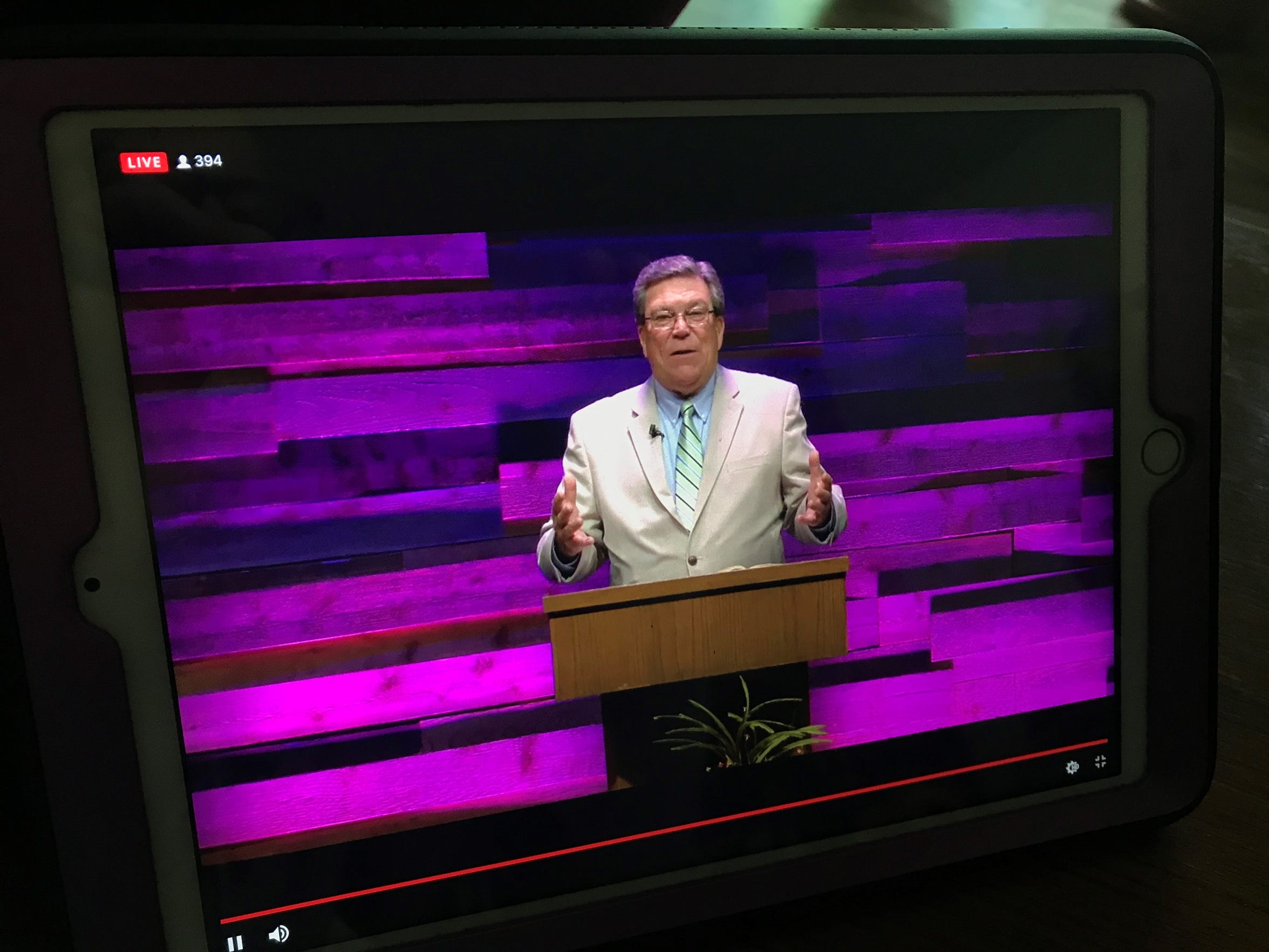 Pioneer Drive Baptist Church pastor Stan Allcorn is seen on an electronic device Sunday morning, when his final Easter sermon was broadcast from the church instead of the Abilene Convention Center.