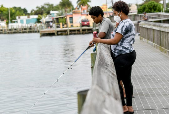 Corine Malave and her son Jarvis Howell get in a little fishing along the Indian River at Intercoastal Waterway Park Saturday, April 11, 2020. Mandatory Credit: Craig Bailey/FLORIDA TODAY via USA TODAY NETWORK