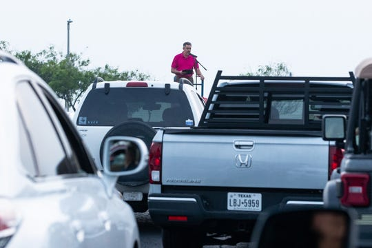 Pastor Brian Hill in the parking lot of the First Baptist Church Corpus Christi leads a drive-in Easter service on Sunday, April 12, 2020. First Baptist Church Corpus Christi had not held an in-person service since Nueces County issued a stay at home order due to the COVID-19 outbreak.