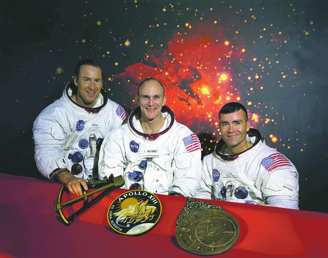 """This is the official NASA photo of the Apollo 13 crew. From left: Commander James A. Lovell, Command Module pilot Thomas K. Mattingly and Lunar Module pilot Fred W. Haise. Mattingly was exposed to German measles before the mission and was replaced by his backup, John L. """"Jack"""" Swigert Jr."""