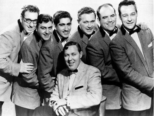 "Pioneer rock 'n roller Bill Haley, seated, with his Comets are shown in a publicity photo from the 1956 film, ""Rock Around the Clock."""