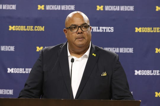 Warde Manuel takes questions about his new head basketball Juwan Howard Thursday, May 30, 2019 at the Crisler Center in Ann Arbor, Mich.