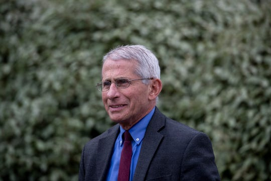 Dr. Anthony Fauci, director of the National Institute of Allergy and Infectious Diseases, walks back inside after doing a television interview at the White House, Friday, April 10, 2020, in Washington. (AP Photo/Alex Brandon)
