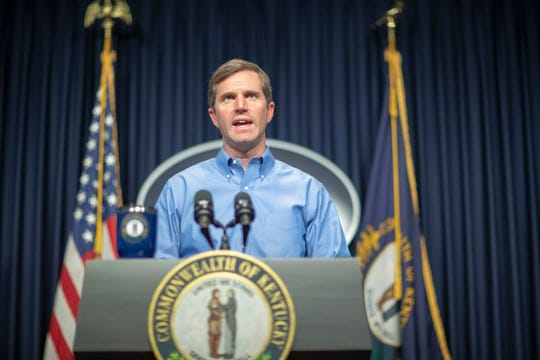 In this Sunday, April 5, 2020, photo, Kentucky Gov. Andy Beshear speaks about the novel coronavirus during a media conference at the state Capitol in Frankfort, Ky.
